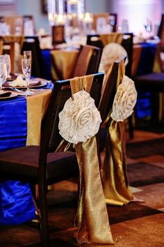 Gold and royal blue chair and table decorations - so luxurious!