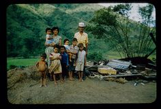 Family standing by remains of house after Hurricane Betsy by t13hman, via Flickr