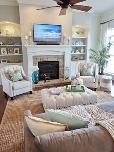 Living room, family room, decor, home decor, fireplace design, but -ins, shelving, Sherwin Williams Conservative Gray, Lamps Plus accent chairs, jute rug, coastal decor.