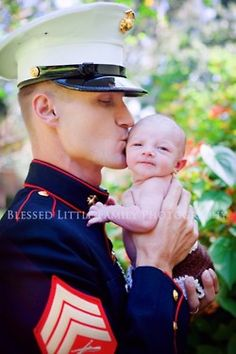 Marine  sees his baby for the first time.