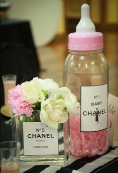 Pink baby bottles at a Coco Chanel baby shower party! See more party planning ideas at CatchMyParty.com!