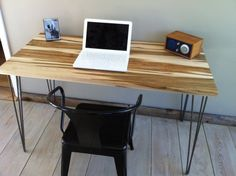 """Mid century modern desk featuring wormy maple top and hairpin legs, 18"""" x 50""""."""