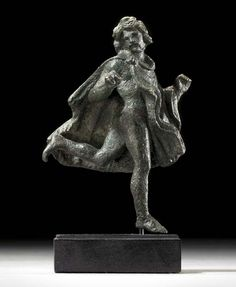 A ROMAN BRONZE RUNNING GAUL CIRCA 1ST-2ND CENTURY A.D.