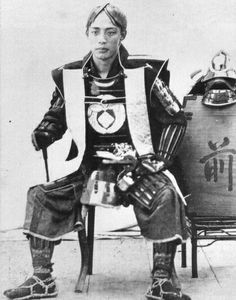 Samurai wearing a jinbaori (war coat), date unknown.