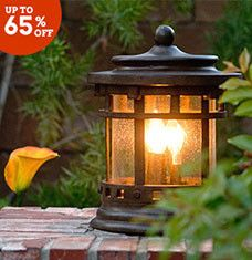 These classic outdoor luminaries let you shed a little light on your lawn or front porch. Sconces and ceiling mounts give visitors a warm welcome, while hanging lights create an enchanting setting for backyard get-togethers. Lead guests to your front door with a stylish post lantern positioned at the end of your driveway.
