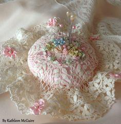 Pincushion (vintage reproduction) using lace and silk ribbonwork.