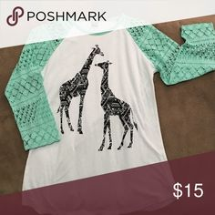 Summer Night Giraffe Print Jersey Style Top Sexy knit sleeves show some shoulder through this unique jersey style top. Soft cotton, slightly longer length gives slimming appearance.  Pair it with some slashed boyfriend crops or cut off shorts. So cut sad to see it go. Worn once. Empyre Tops Tunics
