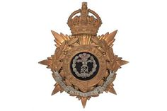 Badge. DCO Middlesex Regiment Officer's helmet plate circa 1901-14. A good gilt example. Crowned
