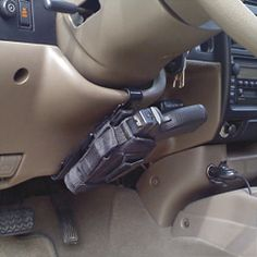 NRA Steer Clear Vehicle Holster Mount - links to the strap to connect your holster and gun to the vehicle. Neat idea.