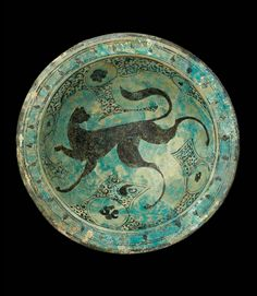 Fritware dish, painted in black under a transparent, turquoise glaze Syria, Raqqa; beginning of 13th century
