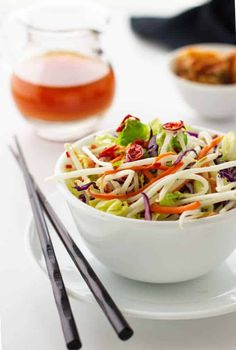 An Asian-inspired Kimchee Slaw of vibrant vegetables is a healthy salad with fermented kimchi. This crunchy, crisp slaw is a great side dish. Slaw Recipes, Salad Dressing Recipes, Healthy Salad Recipes, Vegetarian Recipes, Savory Salads, Potato Recipes, Healthy Eats, Crockpot Recipes, Healthy Snacks