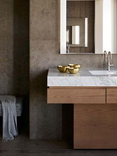 Surprising combination of materials that work - wood, concrete and marble for luscious dark luxury in your bathroom