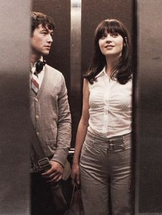 """Joseph Gordon Levitt and Zooey Deschanel in the elevator """"The Smiths - There is a Light That Never Goes Out"""" Scene. On set for 500 Days of Summer."""