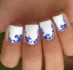 Nice White nails with blue flower accents  The post  White nails with blue flower accents…  appeared first on  Nails .