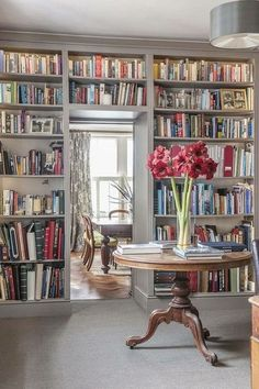 """Stuffed bookcases and blooming vases ~ my definition of """"domestic heaven!"""""""