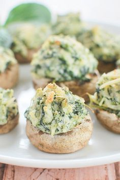 Spinach and Artichoke Stuffed Mushrooms - everything you love about spinach artichoke dip stuffed into mushrooms! Perfect football food!
