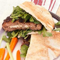 Feta-Stuffed Pita Burgers Stuff pita bread with these grilled, beef-and-lamb burgers and arugula.