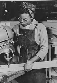 Lucille Little working at the Douglas Aircraft Company in Long Beach, California. - WWII propaganda photo USA, women war workers, African-Americans