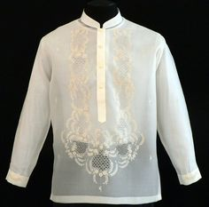 Jusi Barong Tagalog #1030 This simple embroidered Barong Tagalog is the height of good taste in formal dressing. The jusi with detailed embroidery creates an admirable style statement. Its shape and mandarin collar complete the effortless look. Coordinate with your best dress pants and it will be a sure winner. #BarongsRUs #barong