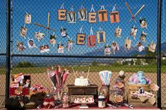 red, white and blue vintage baseball themed birthday party        - more food:  peanuts, sunflower seeds, cotton candy, double bubble gum, coke, donuts on a dowel        - baseball outfit photos on a old window