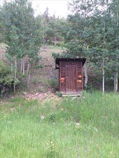 Grandpa Van Blaricum's double hole outdoor port-a-potty. Bonanza Colorado