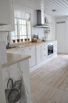 Kitchen, white cabinets, wood, timber floor, scandinavian