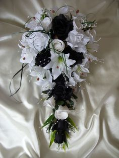 Artificial lily and rose wedding teardrop shower bouquet black white monochrome