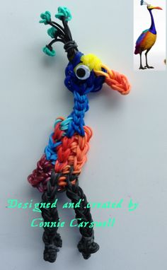 """Rainbow Loom - Characters - KEVIN (Snipe) from the movie """"Up!"""" (photo insert shows the original picture that I used to design HER).  This was my 3rd adn final attempt (and I really think I should stick to """"human"""" characters, but I am really pleased with how it turned out, especially considering the first 2 attempts!!  Designed and created by Connie Carswell May 27, 2014"""
