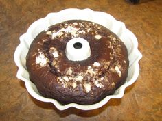 Homemade Chocolate cake with white ghiradelli chocolate chips, Con. sugar and pecans.