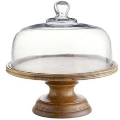 Let them eat cake. But first, tease them by displaying it on this handsome, handcrafted mango wood stand with a clear glass dome top. Its clean lines make your dessert the star. So tantalize their eyes before you serve up the first bite. It will be the best dessert. Ever.
