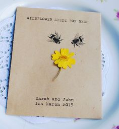 We think these seed packet favours are so unique and unusual! The seed packet is personalised with your wedding details and is made from 80% recycled paper. The wildflower seeds are inside in a sealed plastic wallet and are perfect for bees - they love them! The seeds comprise White Clover, Red Campion and Selfheal - all will come up year after year and can%2...