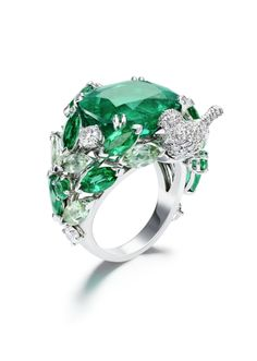 Piaget #Rose Passion #ring in white #gold set with #diamonds, #emeralds and green tourmalines.