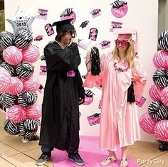 Graduation party *pink* carpet :) Pink plastic table cover roll + grad-cap cutout decorations on the backdrop. Easy!