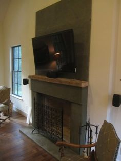 This is my home!  Fireplace by Artistic Surrounds.  I added the wood mantle to their modern design - soho.