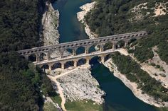 The Pont du Gard is a notable ancient Roman aqueduct bridge that crosses the Gard River in southern France. It is part of a 50 km long aqueduct that runs between Uzès and Nîmes in the South of France. Pont Du Gard, Les Religions, Tours France, France Photos, Birds Eye View, South Of France, France Travel, Wonders Of The World, Romans