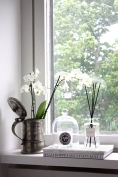 homevialaura | bedroom | window sill | antique silver flower vase | white orchid…