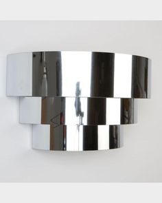 Stepped demilune chrome wall sconces, circa 1960. Available at Remains Lighting Los Angeles.