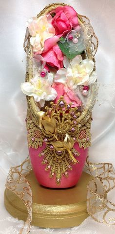 Dark pink and gold decorated pointe shoe. by DesignsEnPointe