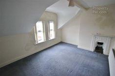165 Alexandra Park Avenue | Bedroom 13'10 x 10'5 (4.22m x 3.18m) Cast iron fireplace | PropertyPal