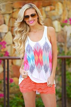 Colorful neon, aztec print racer back tank top, sublimation print. Lightweight, not lined. 95% Poly. 5% Rayon. Tasha is 5'5, size 2, 32D and wearing a small.