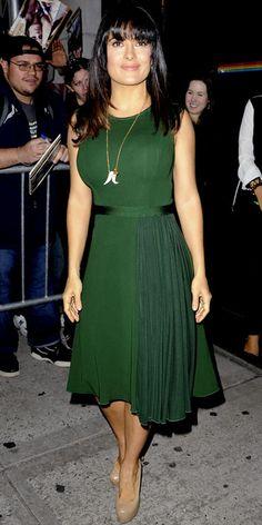 Salma Hayek Pinault hit the street in a green Herve L Leroux dress