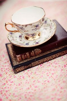 Tea cup and saucer and books of course