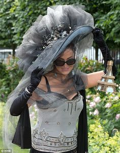 Hold on to your hats! A lady arrives in a crystal embellished grey hat and matching dress...
