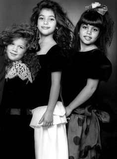 "1987    Khloe, Kim and Kourtney (from left, in family Christmas photo) ""were always girly girls,"" mom Kris Jenner tells Us. ""From a young age, I taught them about waxing and mani-pedis, and we always made it a party!"""