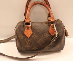 "This cute Louis Vuitton mini-speedy is a perfect LV ""starter"" purse.  It has the traditional LV monogram leather, tan leather double handles, a LV monogram detachable strap, brass fittings, and the brass lock.  This bag has been loved and needs a new zip closure, otherwise it is great condition.  www.handbagconsignmentshop.com"