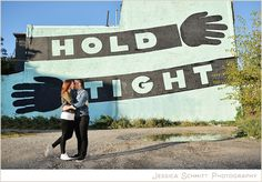 Philly love letter wall murals engagement session. West Philadelphia. HOLD TIGHT