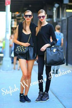 Perfect black blouse with shining black skort skirt and black clutch  black cute blouse and leather black hand bag and black legging and bo...