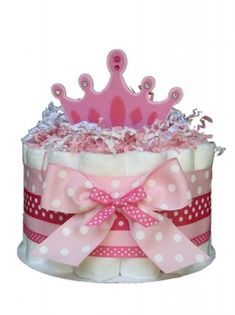 The small Diaper Cake Gift Set includes: a half package of size 1 diapers, beautifully embellished with flowers & ribbon!    Designs may vary.    Visit store for currently available selection or to order your own design.