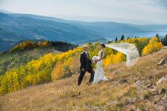 I'm not crazy about destination weddings for the sake of just going some place, but this Vail wedding is beautiful and just the right mix of formal and rustic.