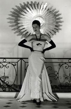 Evening Dress, in front of the 'Sun Clock', George V boutique, 1949. #balenciaga. Tumblr